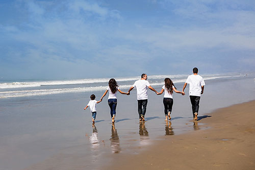 Venice Beach Family Photographer - Five walking on the Beach