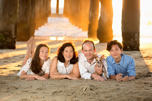 Manhattan Beach Family Photographer - Four with Dog under pier lying down