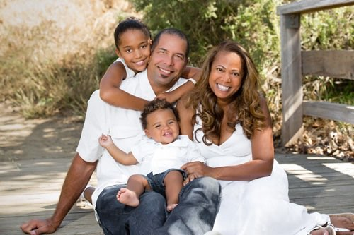 Los Angeles Family Photographer - Four sitting in park wearing white