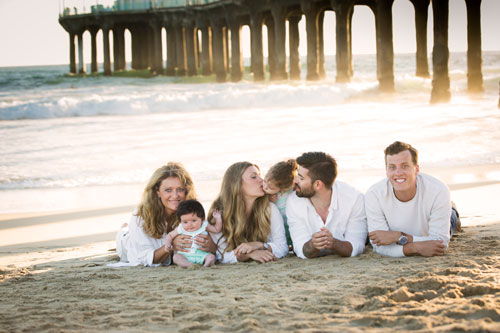 Manhattan Beach Family Photographer - Four with Dog under pier sitting