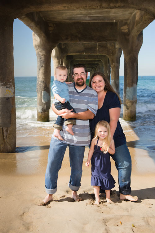 Manhattan Beach Family Photographer - Four standing under pier with two kids