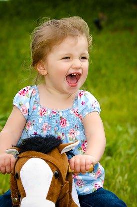 Los Angeles Child Photographer -  Hobby Horse Little Girl Smiling