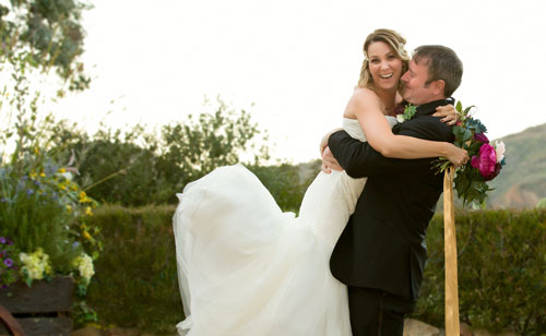 Los Angeles Wedding Photographer - Groom picks up the bride Quote