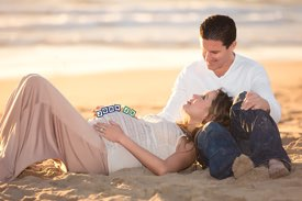 Manhattan Beach Maternity Photographer -  Couple on the Beach with Baby Blocks