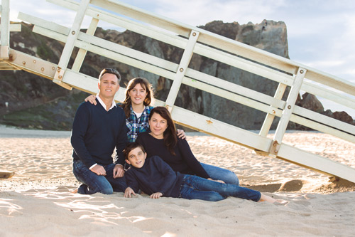Family Photography in Malibu - Sitting in Front of Lifeguard Stand