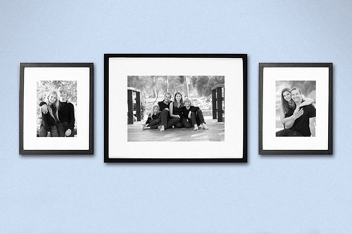Three Matted Framed Prints on Wall